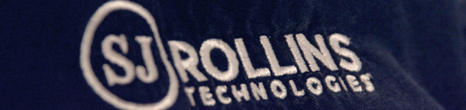 sj rollins technologies logo on shirt